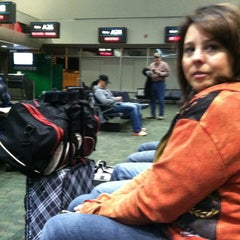 Photo taken at Gate A27 by Scott R. on 12/29/2012