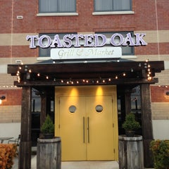 Photo taken at Toasted Oak Grill & Market by Katie G. on 4/18/2013