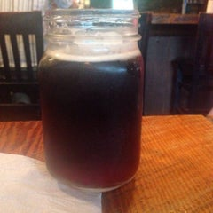 Photo taken at The Lodge Beer and Growler Bar by Zach L. on 8/5/2015