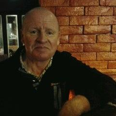 Photo taken at Buddy Bar & Café by Yin J. on 12/28/2012