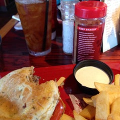 Photo taken at Red Robin Gourmet Burgers by Dan O. on 7/11/2014