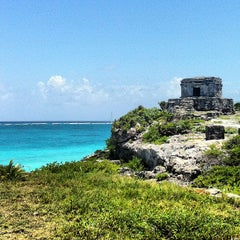 Photo taken at Zona Arqueológica de Tulum by Mary L. on 7/24/2013