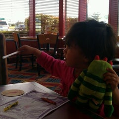 Photo taken at Red Robin Gourmet Burgers by Sruthi B. on 9/29/2012