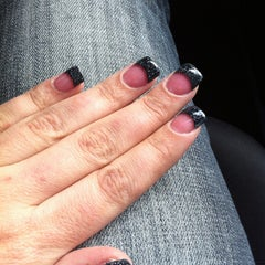 Photo taken at Elegant Nails by Tory W. on 2/6/2013