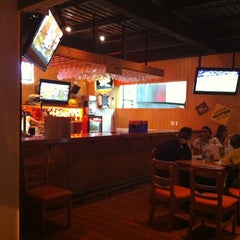 Photo taken at Hooters by Santiago B. on 1/6/2013