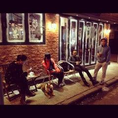 Photo taken at Buddy Bar & Café by SATOSHI H. on 12/9/2012