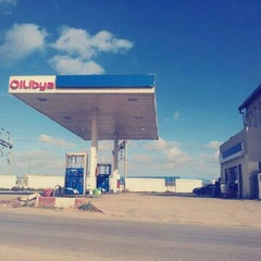 Photo taken at Oilibya by Amine B. on 12/26/2012