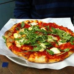 Photo taken at Pizzetta 211 by Pannarai D. on 2/18/2013