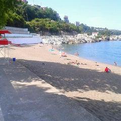 Photo taken at Kapuz Plajı by Sertaç P. on 5/26/2013