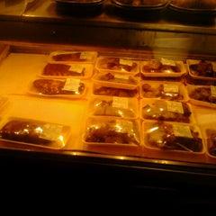 Photo taken at Tamura Super Market by Robert E. on 12/25/2012