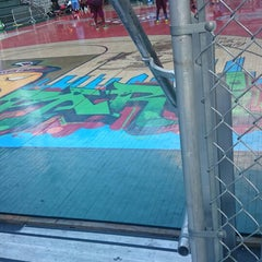 Photo taken at Rucker Park Basketball Courts by Dennis H. on 8/9/2014