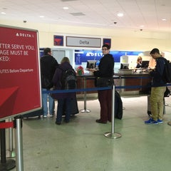 Photo taken at Delta Air Lines Ticket Counter by Sandra J. on 12/27/2012