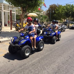 Photo taken at Παραλία Μαρμαρίου (Marmari Beach) by Burak G. on 7/21/2015