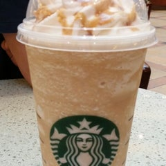 Photo taken at Starbucks by Lucia Hesty S. on 3/30/2014