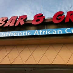 Photo taken at Trinity African Bar & Grill by D. G. on 12/30/2012