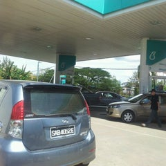 Photo taken at Petronas by Genevieve G. on 12/31/2011