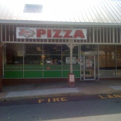 Photo taken at Luigis Pizza by Dominic G. on 2/27/2011