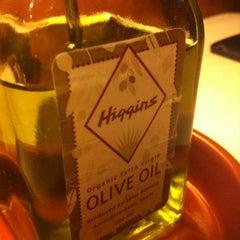 Photo taken at Higgins Restaurant & Bar by Sangraal A. on 3/6/2012