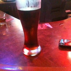 Photo taken at Boston's Restaurant & Sports Bar by Veronica T. on 3/18/2012