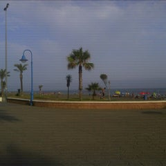 Photo taken at Playa Rincón de la Victoria by Gustavo M. on 7/13/2012