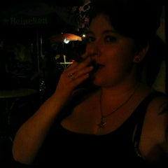 Photo taken at Dos Jefes Uptown Cigar Bar by Lauren D. on 7/4/2012