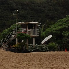 Photo taken at Waimea Bay by Rogerio L. on 3/8/2012
