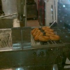 Photo taken at Krispy Kreme Doughnuts by Yolee B. on 5/6/2012