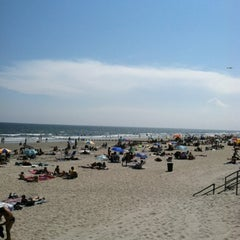 Photo taken at Rockaway Beach by Huey O. on 8/4/2012