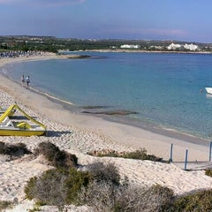 Photo taken at Makronissos beach by Ivan S. on 5/13/2013