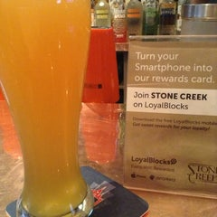 Photo taken at Stone Creek Bar and Lounge by Milton O. on 5/25/2013