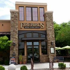 Photo taken at Firebirds Wood Fired Grill by Stelios S. on 8/25/2015