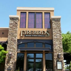 Photo taken at Firebirds Wood Fired Grill by Stelios S. on 8/16/2015