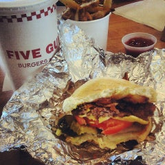 Photo taken at Five Guys by Rebecca O. on 6/19/2013