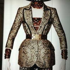 Photo taken at Alexander McQueen by Boon Y. on 3/12/2013