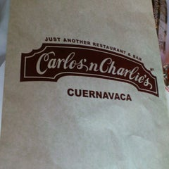Photo taken at Carlos' n Charlie's by Jack R. on 3/23/2013