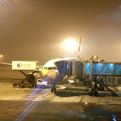 Photo taken at Gate E23 by Ivan T. on 12/19/2012