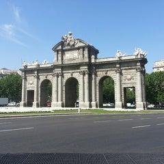 Photo taken at Puerta de Alcalá by Patricia G. on 6/27/2013