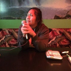 Photo taken at Karaoke Hut Sports Bar & Grill by Kaonohi B. on 3/8/2014