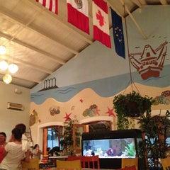 Photo taken at Mariscos Tino's by Claudia G. V. on 1/4/2013