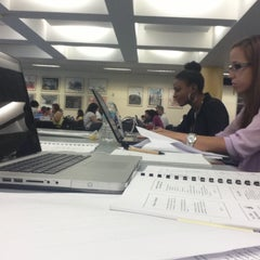 Photo taken at Fiu Green Library by Elisa R. on 4/14/2013