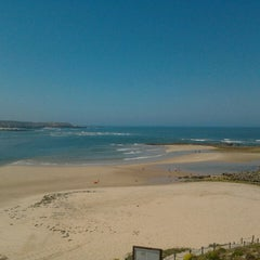 Photo taken at Praia de Vila Nova de Milfontes by Ana L. on 5/25/2013