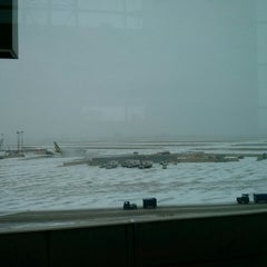 Photo taken at Gate D25 by Erika T. on 2/6/2014