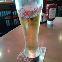 Photo taken at Boston's Restaurant & Sports Bar by Christian O. on 9/2/2013