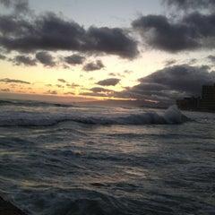 Photo taken at Waikiki Beach Walls by Jered B. on 6/5/2013