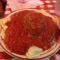 Photo taken at Filippi's Pizza Grotto by Reggie H. on 1/25/2014