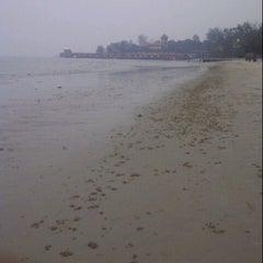 Photo taken at Pantai Saujana (Pantai Batu Empat) by Ayish M. on 6/15/2013