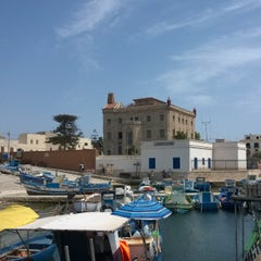 Photo taken at Porto Turistico Marina Di Favignana by Omar D. on 8/1/2015