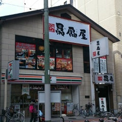 Photo taken at セブンイレブン 江坂エスコタウン店 by CH L. on 12/21/2012