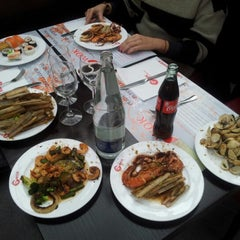 Photo taken at Wok Hui Feng by Filipe S. on 12/21/2012