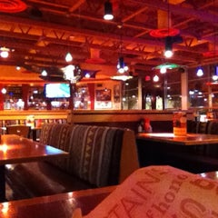 Photo taken at Red Robin Gourmet Burgers by Alex M. on 12/15/2012